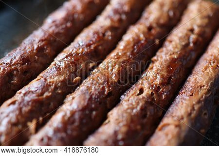 Closeup Of Grilled Meaty Appetizing Fried Sausages