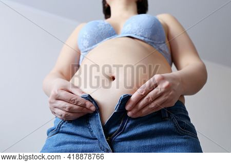 Diet And Overweight, Woman In Bra With Naked Belly Trying To Button Her Jeans. Weight Loss, Trying O