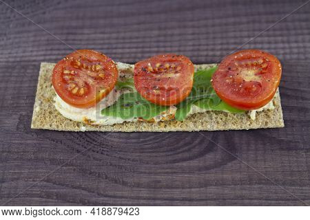 A Crispy Snack With Fresh Tomatoes And Arugula. Healthy Natural Snack, Close-up