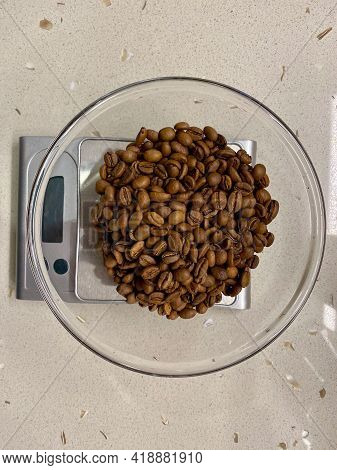Weigh Out The Coffee Beans On Scales. Weighing On Kitchen Surface. Ready To Use.