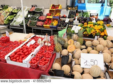 Greengrocer's Stall With Lots Of Fresh Products For Sale In The Fruit And Vegetable Market With Pric