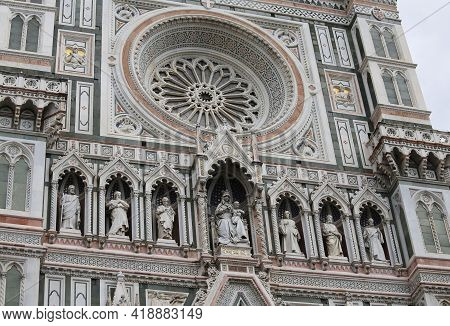 Gothic Facade With Sculpture And Big Window Of The Duomo Of Florence In The Tuscany Region Of Centra