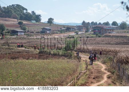 Shan State, Myanmar - January 6 2020: A Tourist Group Hikes From Kalaw To Inle Lake On A Trail By Ch