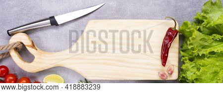 Cutting Board On The Table. Handmade Chopping Board. Fresh Vegetables, Spices And A Cutting Board.
