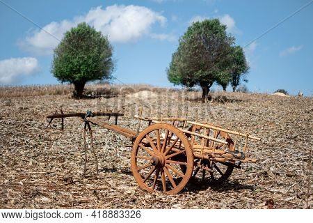 A Beautiful Old Wooden Wagon With Two Wheels On A Rural Farm Field Between Kalaw And Inle Lake, Shan