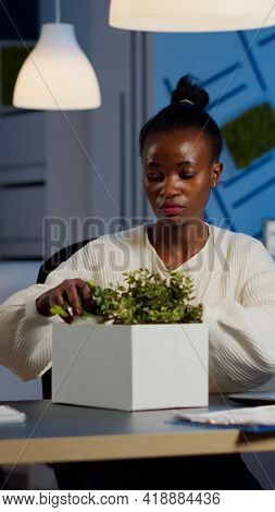 Sad African Fired Businesswoman Packing Things In Box Being Dismissed From Job