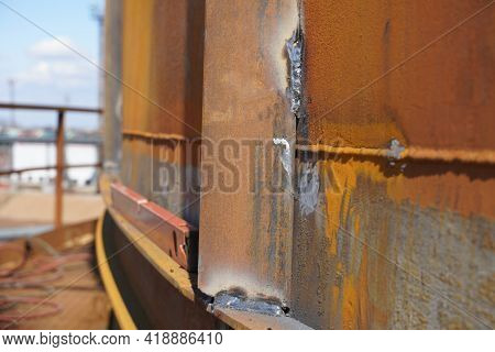 Manual Arc Welding. Defective Butt Weld Of Welding Of Metal Sheets. Repair Of A Tank For Storing Oil