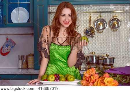 Sexy Woman In The Kitchen, She Flirts. Concept Of Woman And Home Made Food. Attractive Lady In Linge