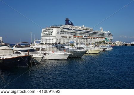Mykonos, Greece - July 27, 2016 : A Big Cruise Ship And Smaller Private Boats At The Port Of Mykonos