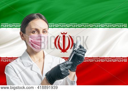 Girl Doctor Prepares Vaccination Against The Background Of The Iran Flag. Vaccination Concept Iran.
