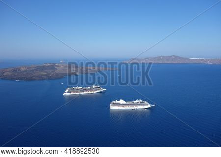 Santorini, Greece - July 30, 2014 : Panoramic View Of Two Cruise Ships Next To The Caldera, And A Be