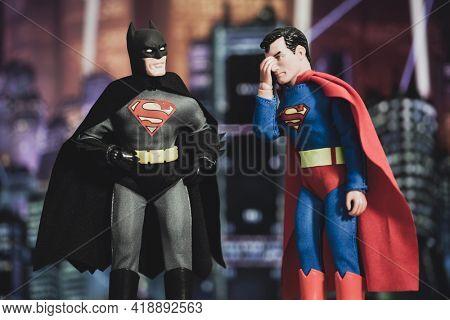 APRIL 27 2021: Mashup of DC Comic superheroes Batman and Superman, Batman wears the Superman S on his chest while Superman facepalms - Mego Corporation action figures