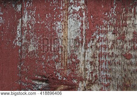 Old White Wood Covered With Dried And Disappearing Red Paint.