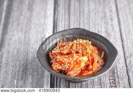 Top View Of Traditional Korean Dishes Or Kimchi In A Bowl On Wooden Table. Space For Text. Concept O