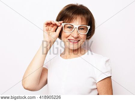 Lifestyle and old people concept: Smiling senior woman wearing glasses and smiling