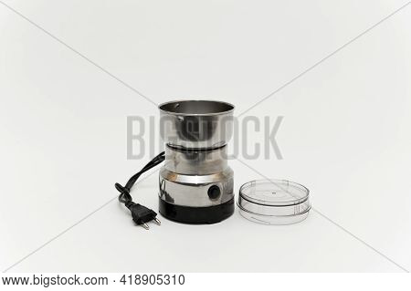 Coffee Grinder On A White Background. Coffee Machine On A White Background. Electric Coffee Grinder.