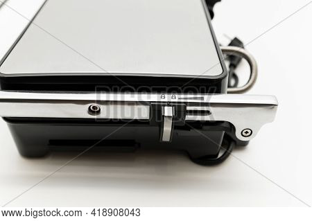 Electric Grill On A White Background. Mode Wheel And Electric Grill Control Panel. Household Applian
