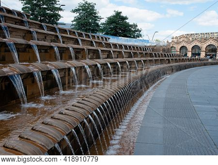 United Kingdom, Sheffield- June, 21, 2019: The Water Fountain At The Sheaf Square With The Railway S
