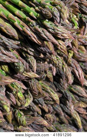 Asparagus at an outdoor farmers' market.