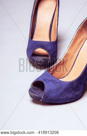 Womens Violet Worn Shoes High Heels On Gray Background. After Party, Fashion Concept. Side View