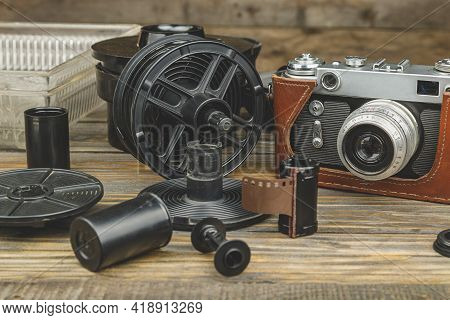 Developing Tank With Vintage Camera And Photo Film Rolls. Photo Film Development Home Concept