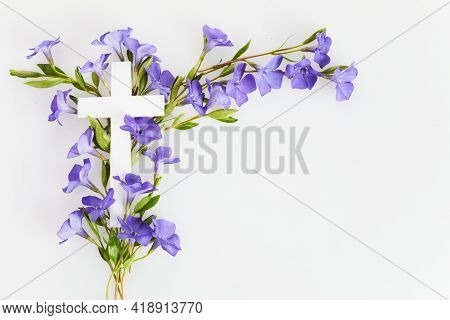 The Christianity Cross Of Beautiful Blue Periwinkle Flower. Baptism, Easter, Church Holiday Backgrou