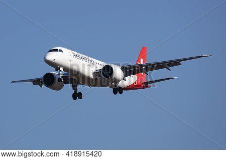Budapest, Hungary - March 9, 2020: Helvetic Airways Embraer 190 Erj-190 E2 Hb-aza Passenger Plane Ar