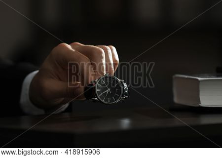 Man Putting Luxury Wrist Watch On Table, Closeup. Space For Text