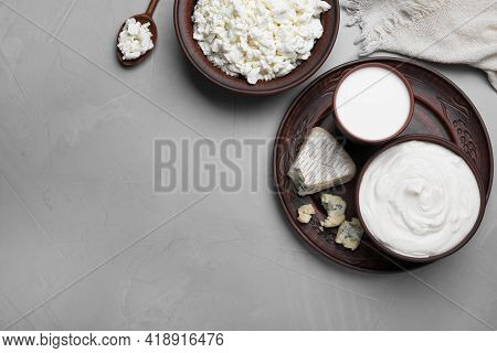 Clay Dishware With Fresh Dairy Products On Grey Table, Flat Lay. Space For Text