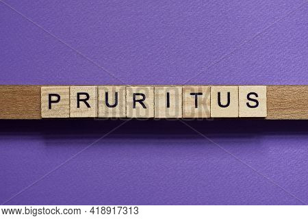 Brown Word Pruritus In Small Square Wooden Letters With Black Font On A Lilac Background