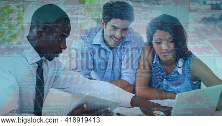 Composition of computer processor over business people using laptop. global technology, data processing and digital interface concept digitally generated image.