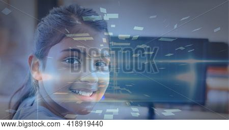 Composition of tunnel with colourful rectangles over smiling schoolgirl using computer. global technology, data processing and digital interface concept digitally generated image.