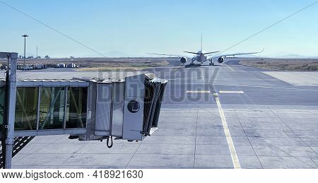 Jet Bridge With Aircraft Driving By The Runway Before Airplane Takeoff. Airways And Transportation C