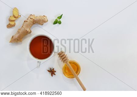 Ingredients For Herbal Ginger Tea With Honey, Star Anise And Anise. Healthy Food Detox Concept. Flat