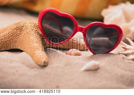 Summer Background. Sunglasses Sand With Seashells, Starfish And Sunglasses. Summer Vacation Concept