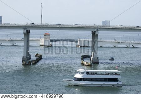 The Ferry Boat Passing By Near Two Bridges In Miami Downtown Harbor (florida).