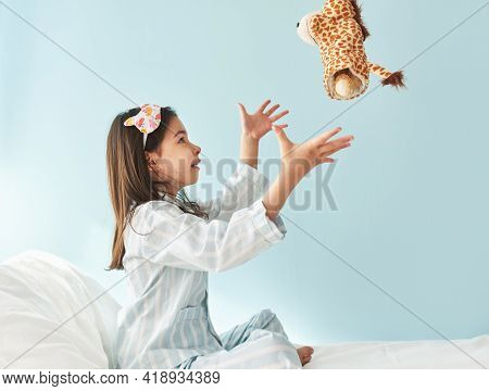 Sied View Of Cute Little Girl In Blue Pajama In White Stripes, Sleeping Mask On Head, Smiling, And P