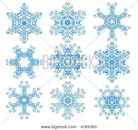 Blue Snowflakes Over White.