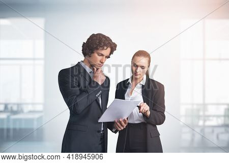Two Business People Young Professionals Working With Papers At Modern Office With Panoramic Windows.
