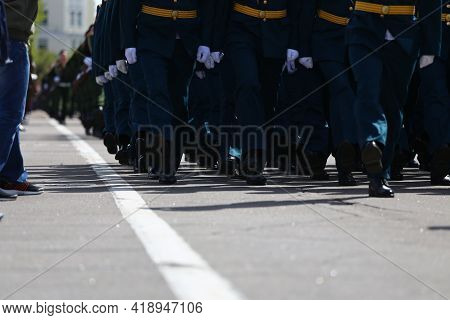 Military Holiday In City, Parade Of Armed Forces Of Country A Solemn March Through Streets Of City,