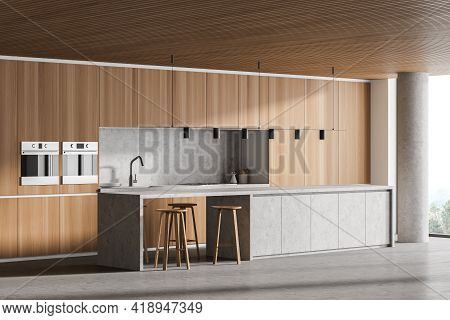Interior Of Modern Kitchen With Wooden Ceiling, Furniture, Table And Chairs. Dining And Cooking Area