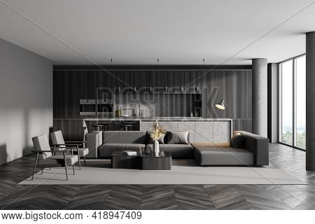 Interior Of Modern Kitchen With Wooden Parquet, Furniture, Table And Chairs, Big Couch In The Middle