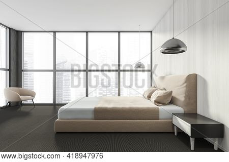 Modern Bedroom Interior In New Luxury Home. Stylish Hotel Room. Open Space Area. Wooden Walls Carpet