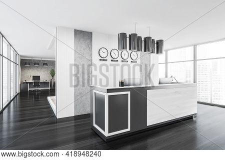 Black And White Entrance Room Interior In Business Office, Clocks On Wall, Office Desk With Computer