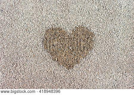 Top View Of Bentonite Cat Litter, Heart Shaped Cat Urine, Focus Foreground