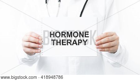 Female Doctor Holding A Notebook With The Name Of The Diagnosis Hormone Therapy. Medical Concept.
