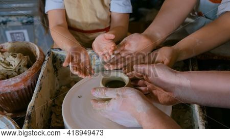 Pottery Class And Workshop - Professional Male Potter Working With Children And Showing How To Make