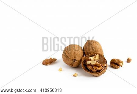 Ripe Walnut And Cracked Walnut On White Background