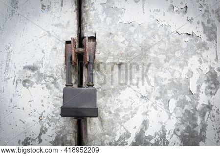 Padlock Hangs On The Door. Close With A Lock. Metal Lock