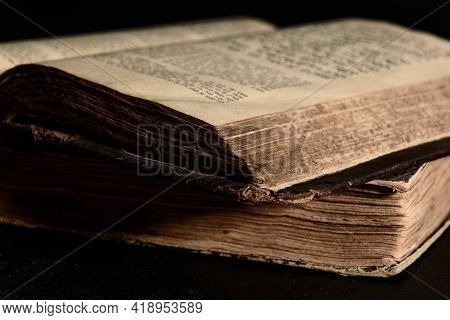 Jewish Bible. Old Worn Jewish Books. Opened Scripture Pages. Selective Focus. Closeup.